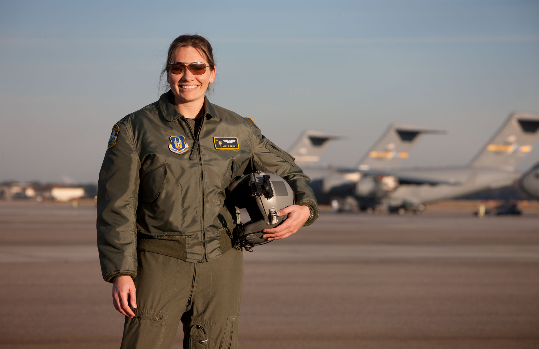 Female Airforce Captain with C-17 transports in background. Photographed for the US Veterans Administration in Charleston, SC.